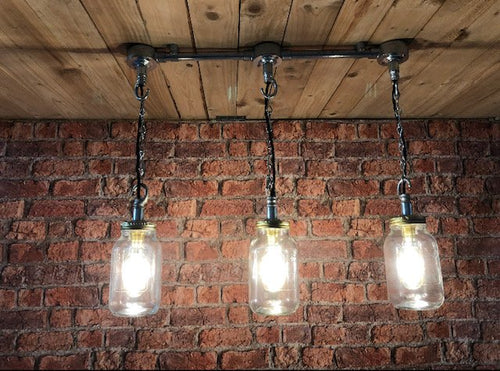 Industrial steel pipe ceiling light, with kilner jars and LED vintage filament lamps. steampunk style bar bistro cafe pub restaurant