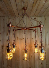 Load image into Gallery viewer, Hanging Mason jars in an 'X' formation with chains and vintage light bulbs in copper