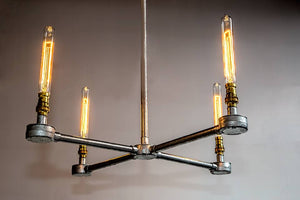 4 arm black steel chandelier made from steel conduit pipe and comes with vintage edison bulbs.