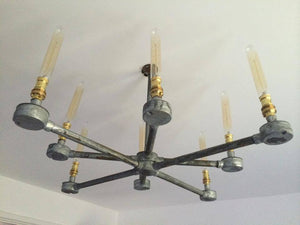 8 arm Steel Chandelier made from galvanised steel pipe and comes with vintage edison bulbs.