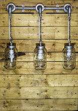 Load image into Gallery viewer, Steel conduit and Jar lights hung on chains