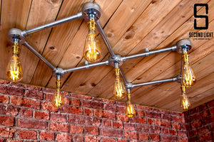 Industrial steel ceiling light with 7 LED vintage filament bulbs