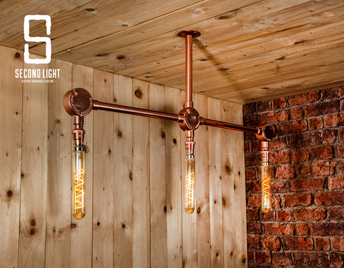 Industrial 3 bar ceiling light finished in copper
