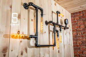 Industrial matt black steel pipe wall light with vintage edison light bulbs