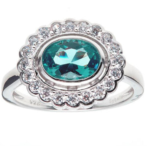 Oval Green And Clear Cz Ring