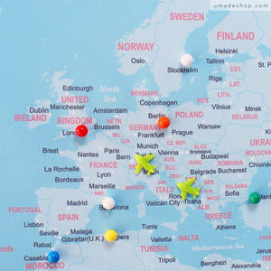 UMade; plan your travel destinations with special color push pins & fly away airplane magnets on the detailed UMap world map.