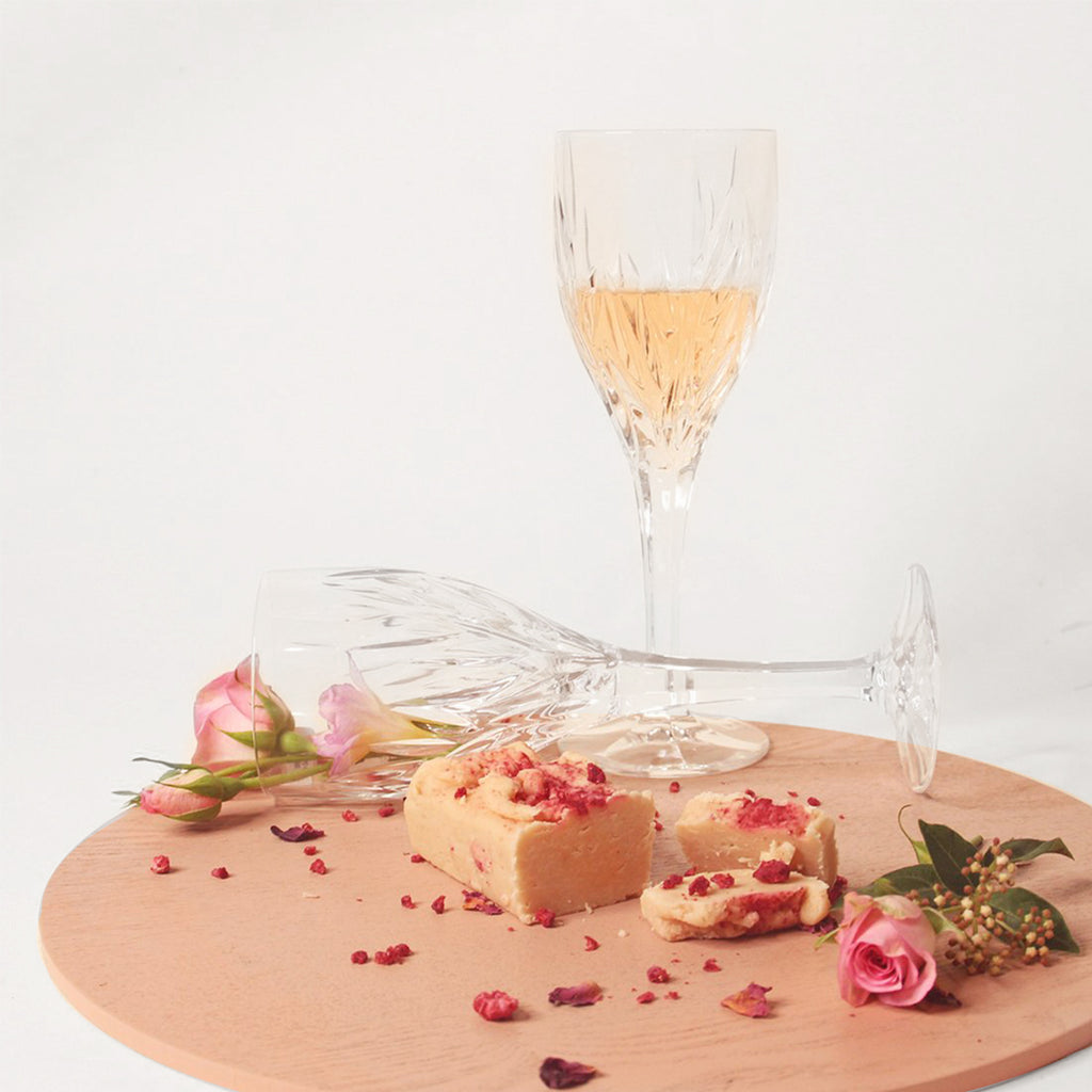 Hello Sailor Bakery Raspberry Rosé Artisan Fudge in front of a glass of Rosé wine with freeze-dried and roses