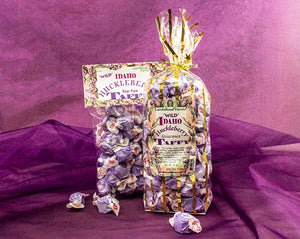 Mouthwatering! Handmade huckleberry sauce makes the best huckleberry taffy! Crafted by the Larchwood Farms family in beautiful gift bags.