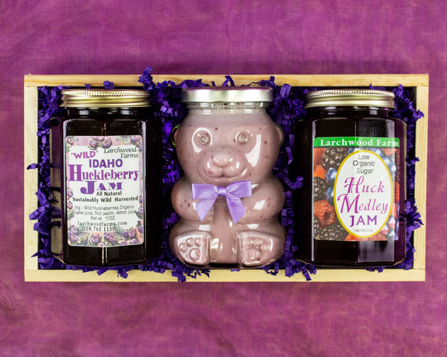 Hand crafted, all natural wild hucklberry bliss bottled and boxed in pine.
