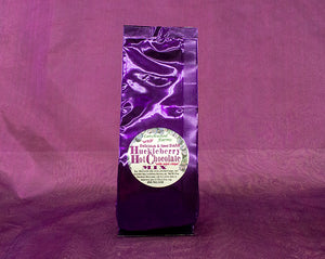 Huckleberry Hot Chocolate with mini chocolate chips beautifully packaged in purple foil bag.