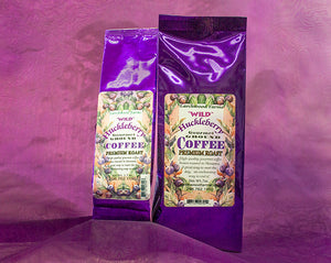 Simply divine huckleberry coffee crafted by Larchwood Farms, tucked into rich purple foil gift bags