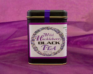 Fine huckleberry black tea in a black, gold rimmed tea tin