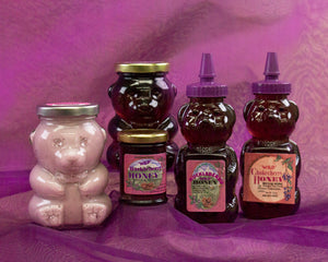 Montana bees and forest berries are honored by Larchwood Farms in this hand crafted huckleberry honey - 12 oz bear