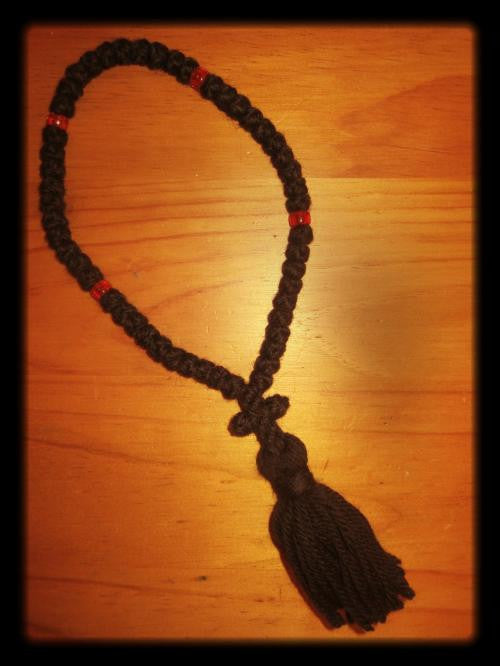 50 knots, black wool, red beads