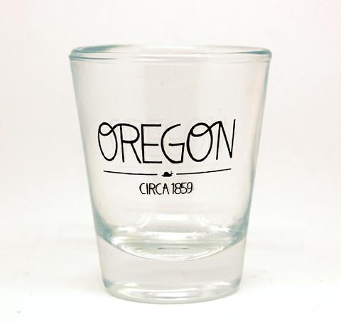 "Clear shot glass with Oregon written on the side and underneath is written ""Circa 1859"""