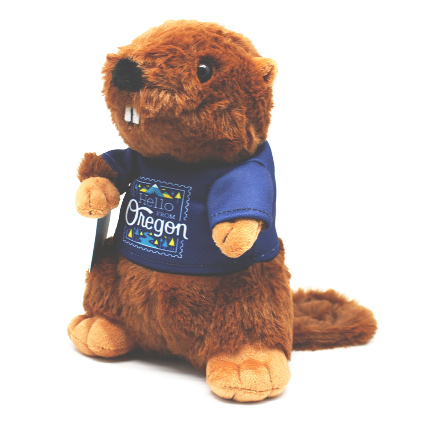 Beaver plushie wearing a blue tshirt with our Hello From Oregon logo.