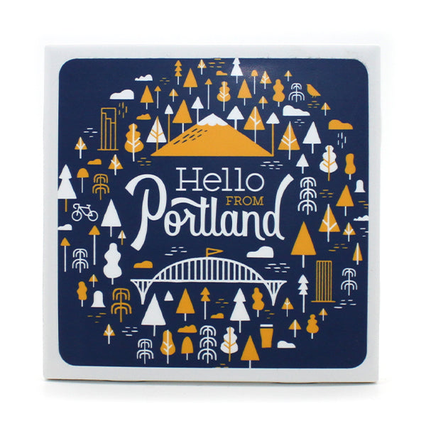 "Navy and Yellow Coaster featuring our popular Portland pattern, with our logo ""Hello From Portland"" written in the center."