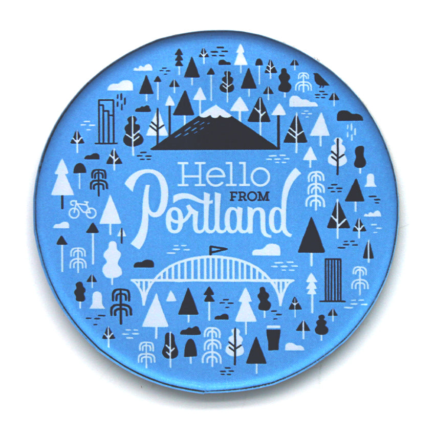 "Light Blue Circle Magnet with our popular Portland pattern in black and white. In the center is our ""Hello From Portland"" logo."