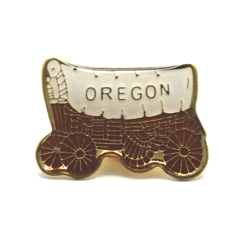 "Gold lined old timey covered wagon with the ""Oregon"" on it."