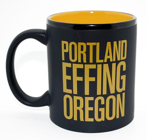 "Yellow and black mug with the words ""Portland Effing Oregon"" written in big letters on the side."