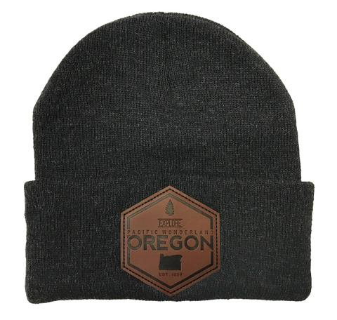 dark grey beanie with hexagon leather patch reading Explore Oregon with state shape and est. date on bottom of leather patch.