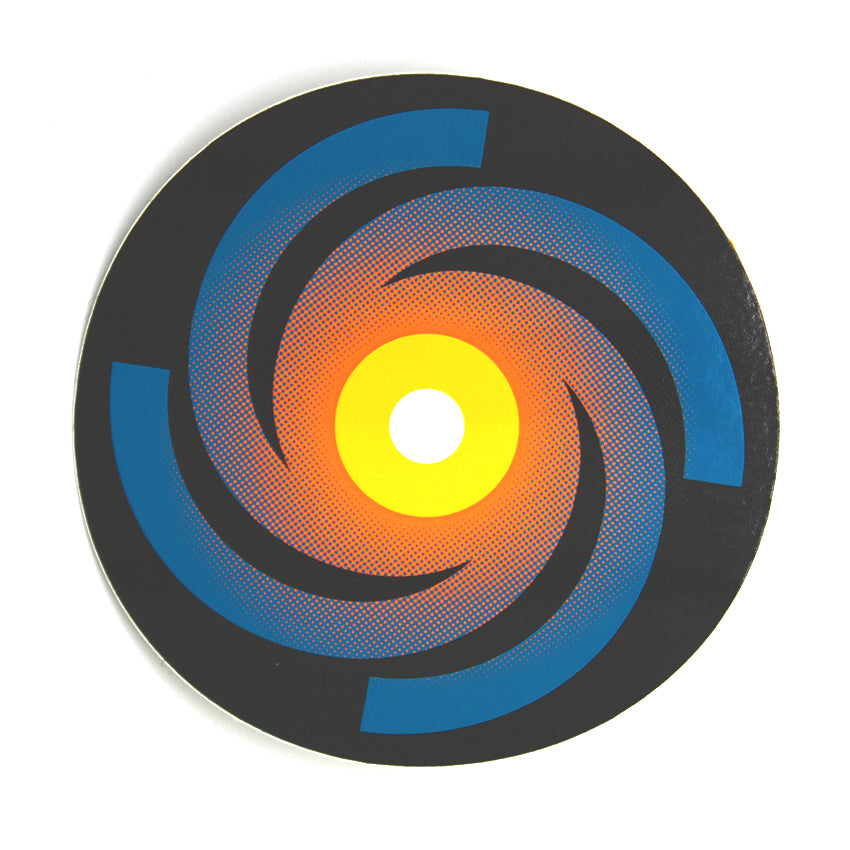 Black circle sticker with blue to orange swirl. In the center is a yellow and white circle.