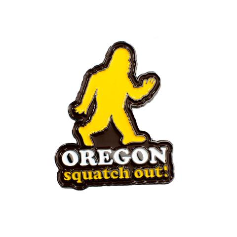 "Brown pin with a silhouette of sasquatch. Below it reads ""Oregon Squatch Out!"""