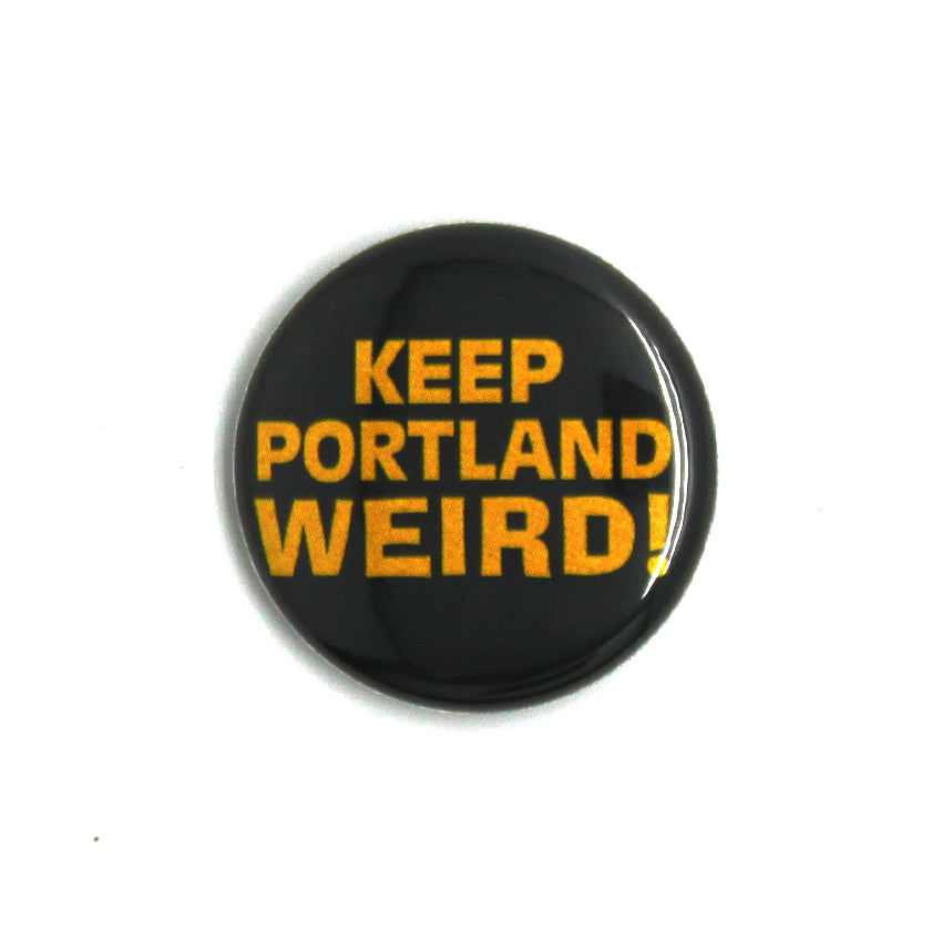 "Black Circle Button that reads ""Keep Portland Weird!"" in yellow letters."