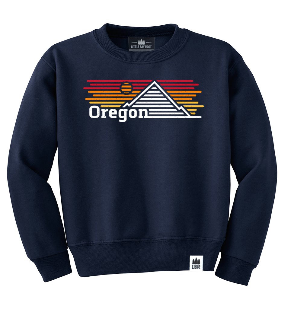 Navy Kid's Crewneck with graphic of mountain and sunset made of horizontal lines. Reads Oregon on bottom left of graphic.