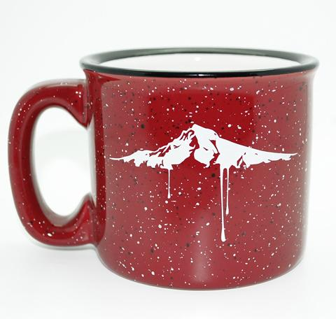 Maroon mug with black and white speckled paint.