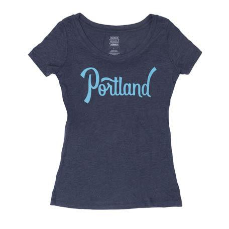 Navy womens scoop neck tee with Portland on the chest in a light blue color.