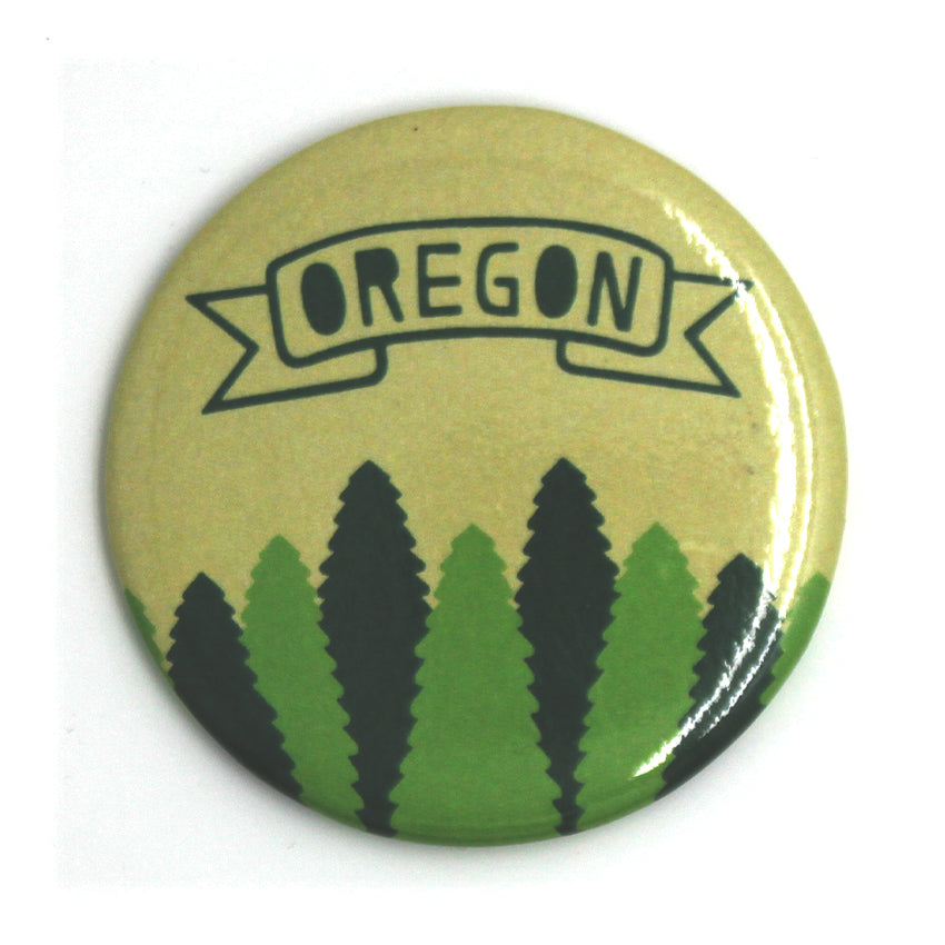 Yellow and green button with trees lining the bottom and a banner with Oregon in the center of it.