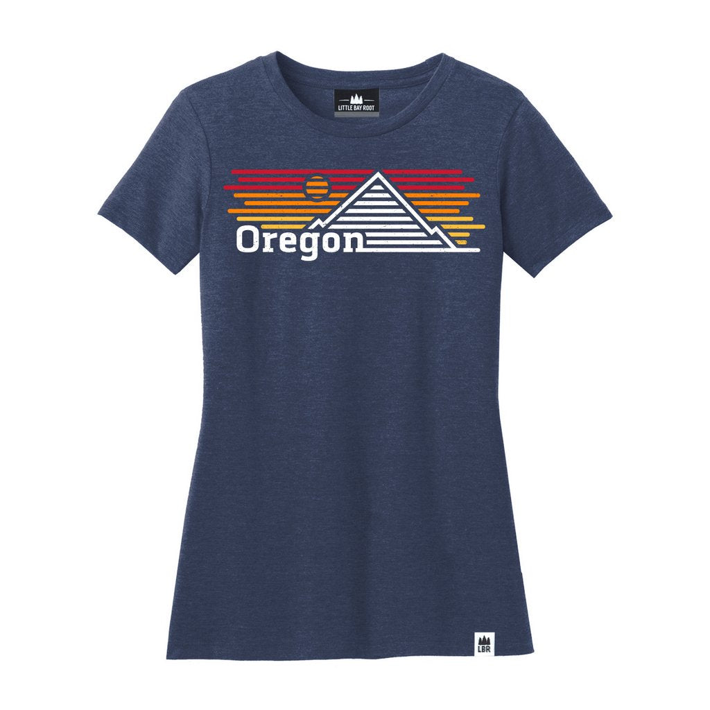 Navy Blue Women's Tee with graphic of mountain and sunset made of horizontal lines. Reads Oregon on bottom left of graphic.