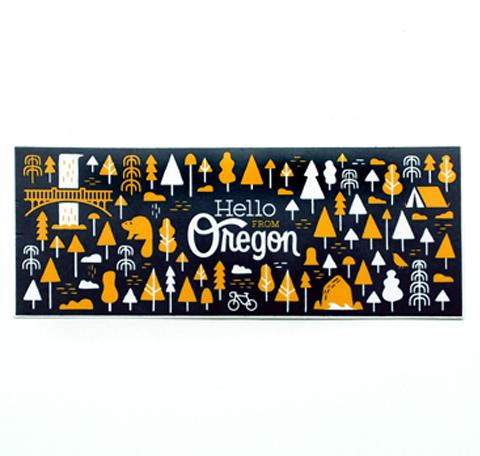 Navy Rectangle sticker with our popular Oregon patter featuring trees, animals, camping and multnomah falls. In the center it reads Hello From Oregon.