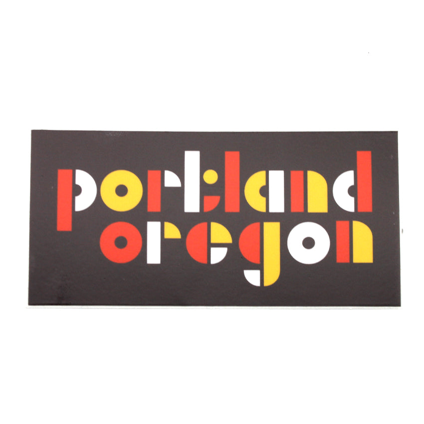 Rectangle orange, yellow and white sticker that reads Portland Oregon in geometric shapes