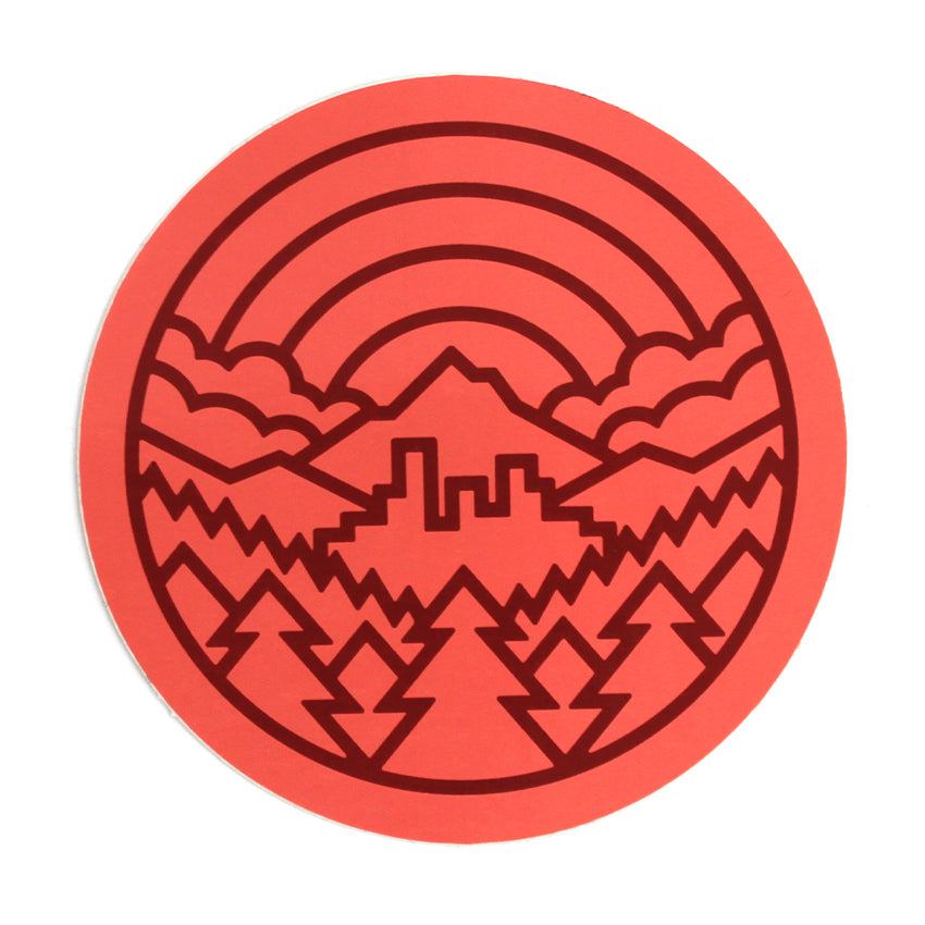 Circle sticker depicting Portland with Mt. Hood in the background, trees in front and a rainbow over everything.