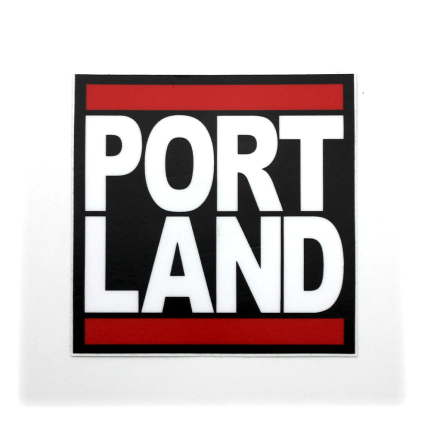 "Black square sticker with the ""Portland"" split and stacked on top of each other with red bars at the top and bottom, in the style of Run DMC's famous logo."