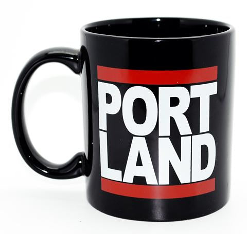 Black Mug with Portland written on the side in the style of the famous Run DMC logo.