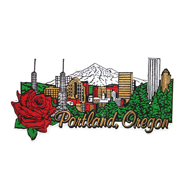 "Rubber magnet depicting the cityscape of Portland. Mt. Hood can be seen in the back and in front there is a rose and ""Portland, Oregon"" written."
