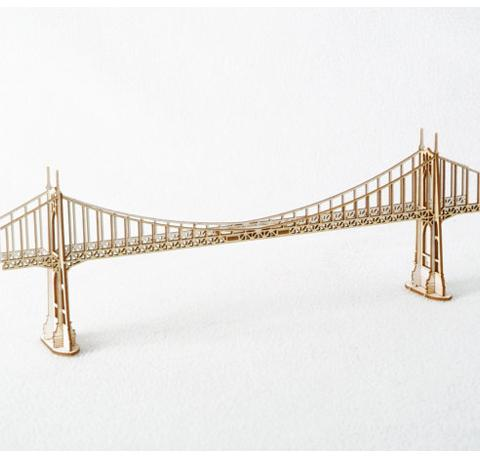 A wooden model kit of Portland's famous St. Johns Bridge. Comes unassembled in a package.