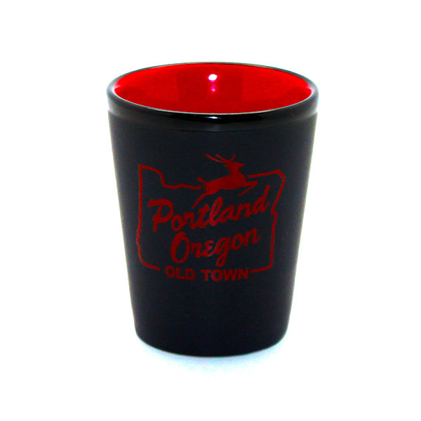 Matte black and red shot glass with an all red Old Town Stag Sign on the side.