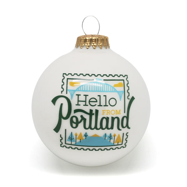White spherical ornament with our Hello From Portland Stamp Logo.