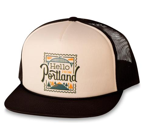 Trucker Hat with white foam front panel and Black lid and mesh back. Hello From Portland Stamp logo on front.