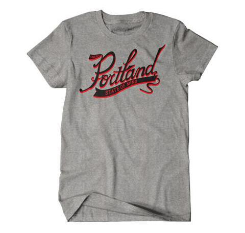 Grey Women's T-shirt with Cursive graphic in the center reading Portland large and on a banner below State Of Mind. In Red and Black Ink.