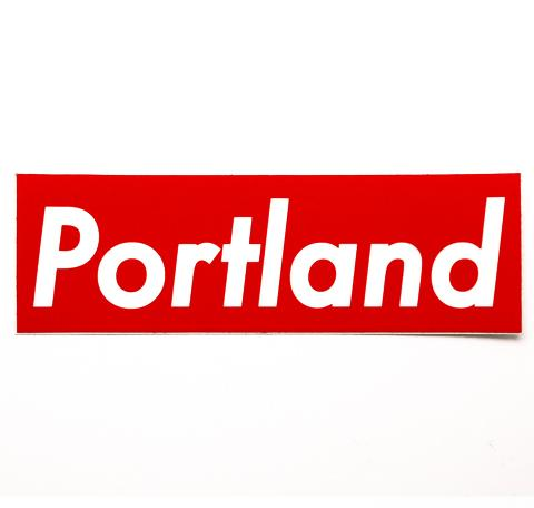 Red rectangle sticker that reads Portland in the style of the streetwear brands, Supreme, logo