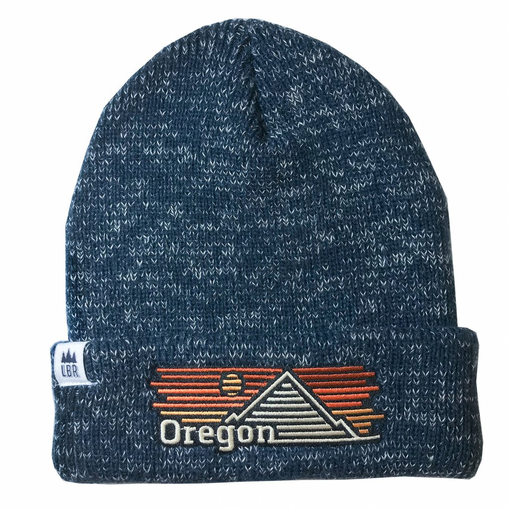 Heathered Blue one cuff beanie with embroidered patch reading Oregon with a mountain and sunset imagery.