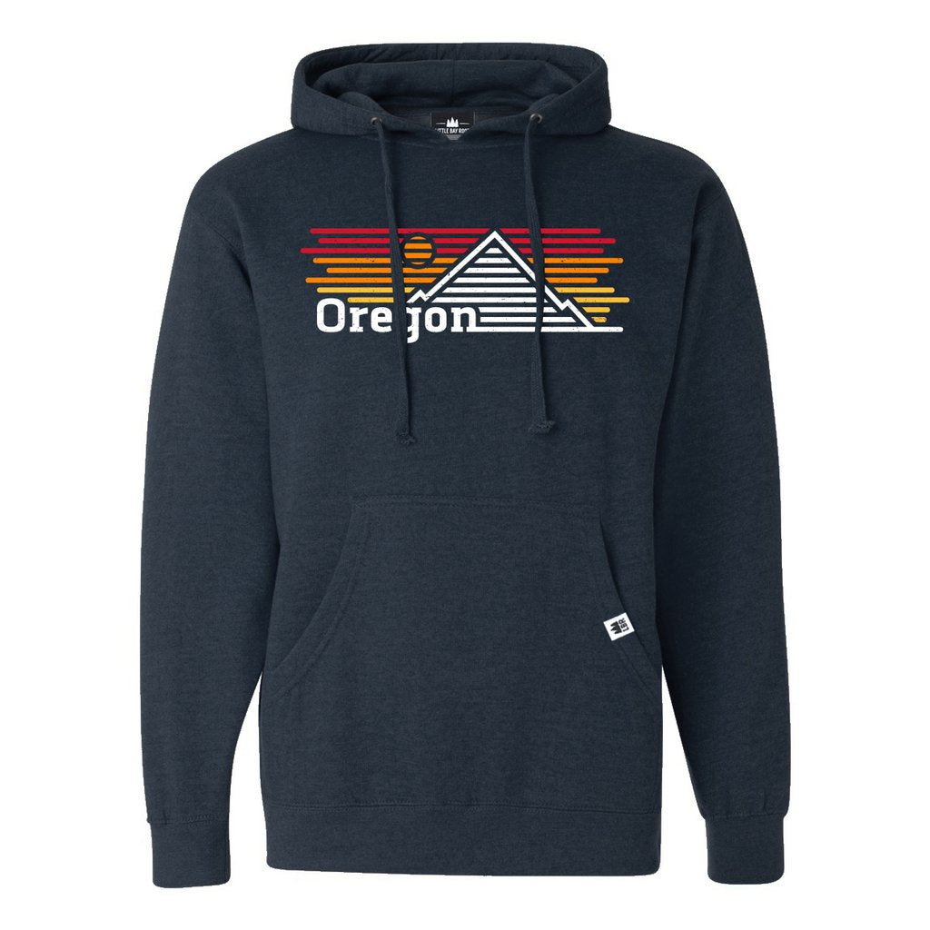 Navy Blue Pullover hoodie with graphic of mountain and sunset made of horizontal lines. Reads Oregon on bottom left of graphic.