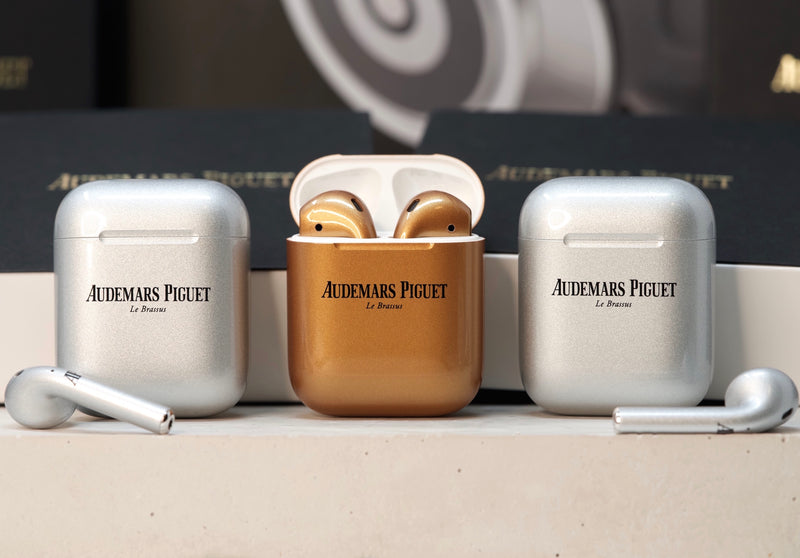 Time Traders Review of Authentic and Real Audemars Piguet AirPods in Rose Gold and Frosted Silver For Sale at www.TimeTradersOnline.com