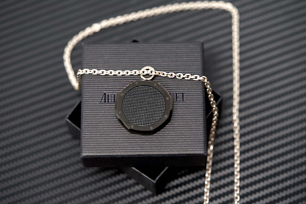 Official AP Royal Oak Jewelry For Watch Collectors For Sale Black Necklace Medallion Swiss Made Audemars Piguet Exclusive Available for Sale by www.TimeTradersOnline.com
