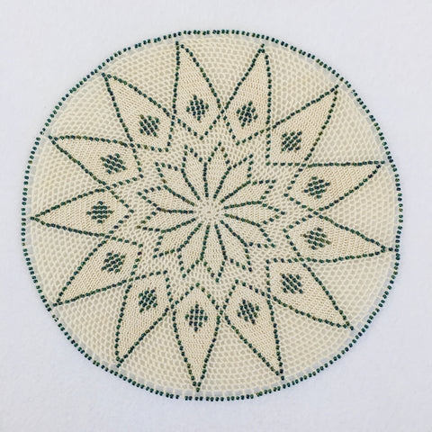 Mandala doily with teal beads